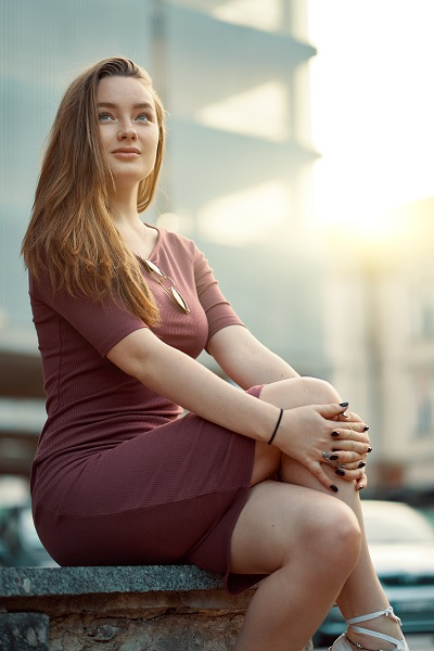 Beautiful lonely Ukrainian girl dreaming and thinking in the morning before going to work